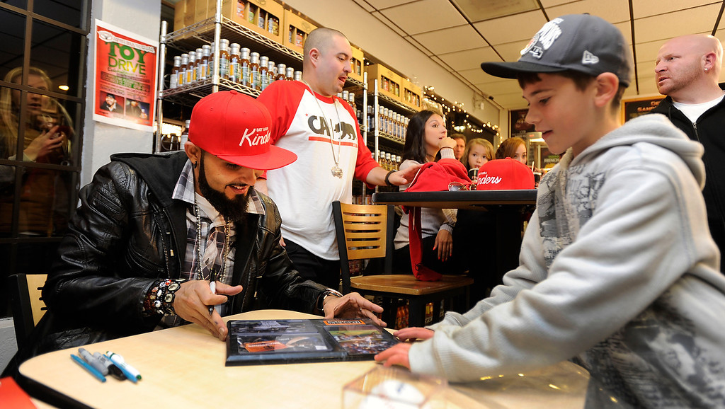 . Justin Ferreira, 11, of Oakley, brings a plaque with a variety of Giants reliever photos on it for the baseball player to sign on Wednesday, Dec. 12,  2012 in Pleasant Hill, Calif. (Susan Tripp Pollard/Staff)