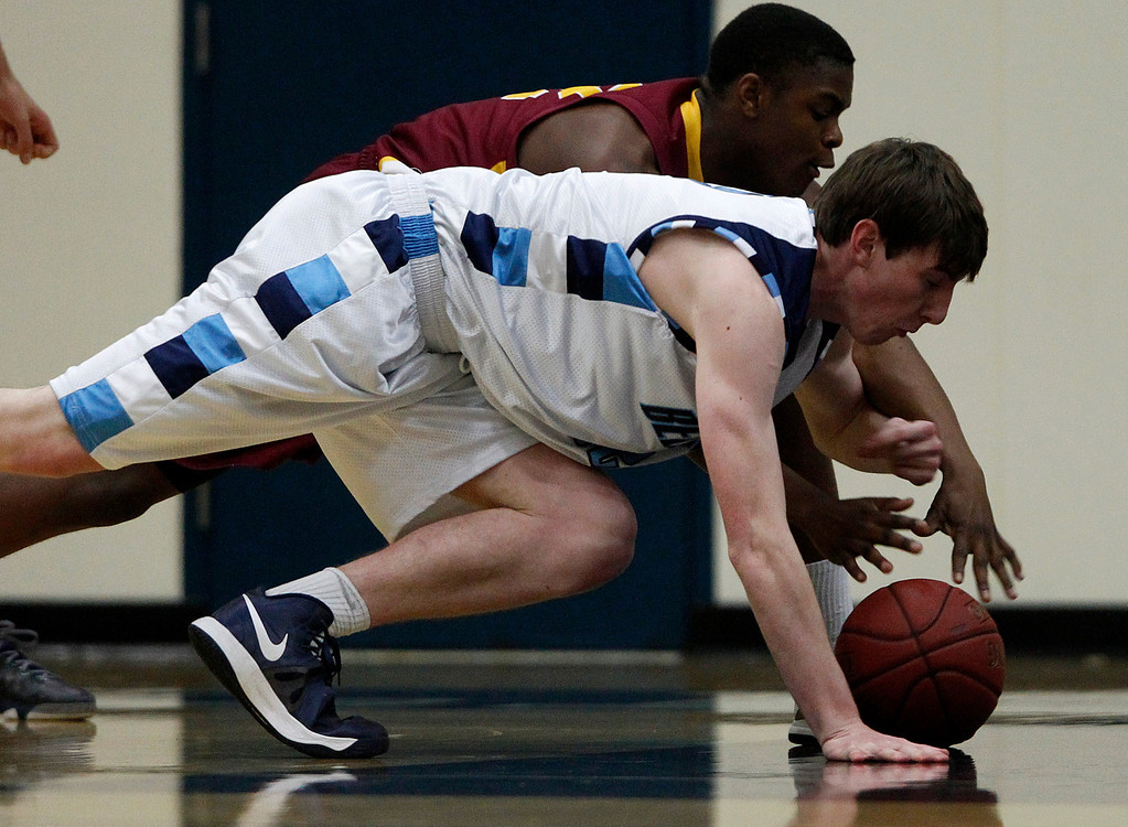 . Bellarmine College Preparatory\'s Jack O\'Hara (32) dives for a loose ball against Lincoln High School\'s Davion Telfor (22) for their NorCal Division I Round 1 game in the first period at Bellarmine College Preparatory in San Jose, Calif., on Wednesday, March 6, 2013.  (Nhat V. Meyer/Staff)