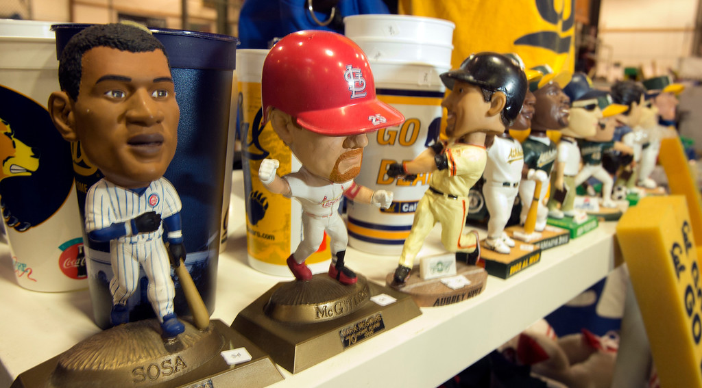 . Vintage bobblehead dolls await the crowds of shoppers who will attend the annual White Elephant Sale, at the Oakland Museum Women\'s Board 96,000-square-foot warehouse in Oakland, Calif., Tuesday, photographed Jan. 15, 2013. (D. Ross Cameron/Staff)