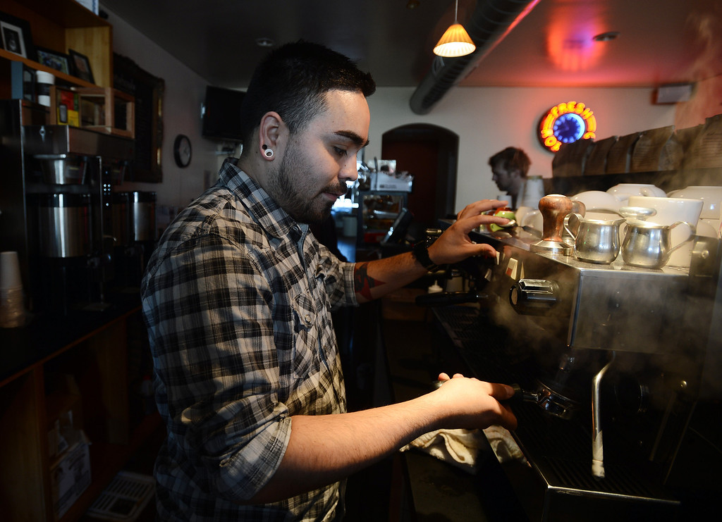 . Catahoula Coffee Company employee Daniel Hernandez works behind the espresso machine at the shop in Richmond, Calif. on Thursday, Jan. 17, 2013. (Kristopher Skinner/Staff)
