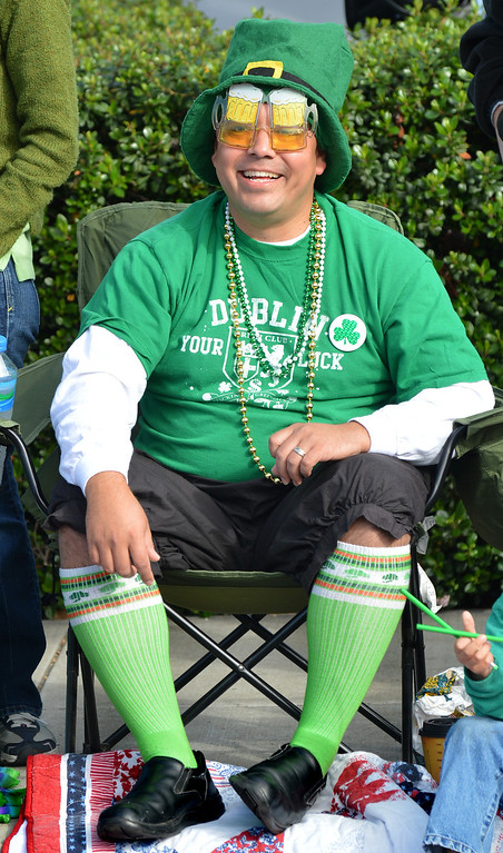 . Dave Briseno, of San Ramon, sits on Dublin Boulevard dressed like a leprechaun and watches the Saint Patrick\'s Day Parade in Dublin, Calif., on Saturday, March 16, 2013. (Dan Rosenstrauch/Staff)