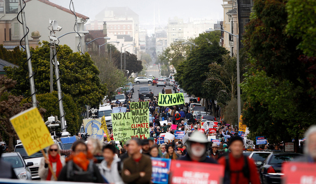. Protesters at the intersection of Pacific Avenue and Baker Street protesting the plan to build a pipeline from Canada to Texas, called the Keystone XL pipeline, in Pacific Heights in San Francisco, Calif., on Wednesday, April 3, 2013.  (Nhat V. Meyer/Staff)