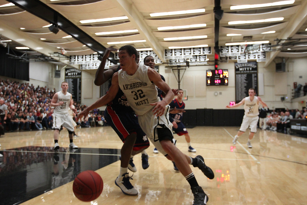 . Archbishop Mitty\'s Aaron Gordon (32) dribbles the ball against Modesto Christian Anthony Townes (33) in the second quarter of NorCal Boys Open Division semi-finals Varsity Boy\'s Basketball game at Archbishop Mitty High School in San Jose,  Calif., on Tuesday, March 12, 2013.  (Josie Lepe/Staff)