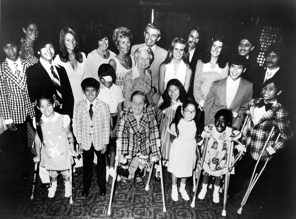 . Dorothy and Bob Debolt with grandmother and children: Mike, 29, Michelle, 28, Stephanie, 26, Noel, 24, Martin, 23, Tich, 22, Ahn, 22, Dat, 21, Trang, 18, Doni, 17, Melanie, 17, Lee, 17, Twe, 16, John Robert (J.R.) 13, Thong, 11, Karen, 10, Sunee, 10, and Wendy, 9, in October of 1977. (Bay Area News Group Archives)
