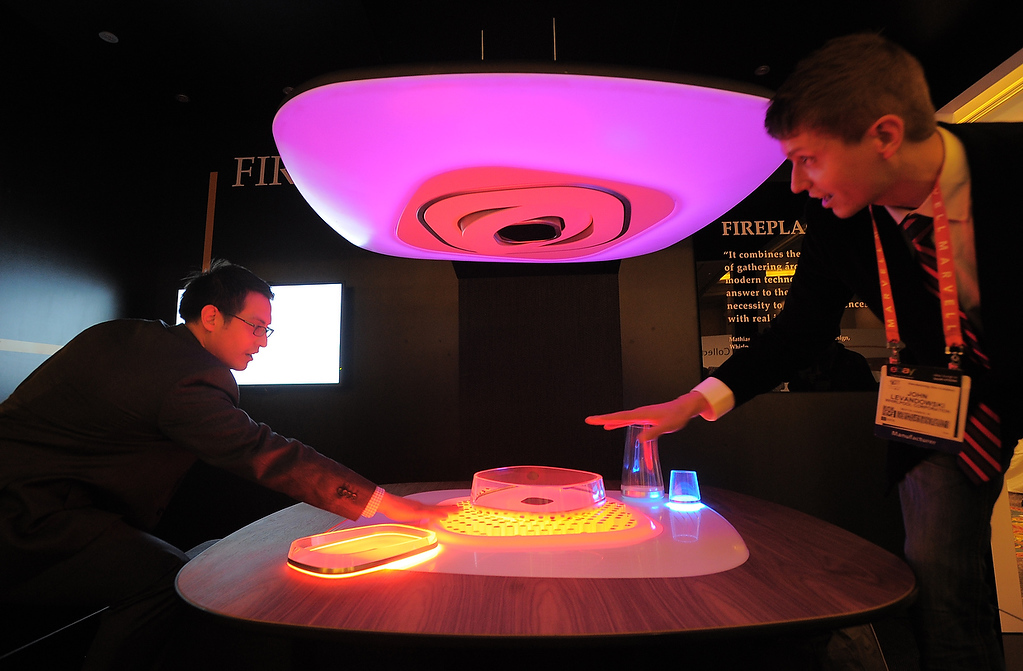 . Whirlpool shows their concept of dining unit called Fireplace,keeping food and atmosphere warm, at the 2013 International CES at the Las Vegas Convention Center on January 9, 2013 in Las Vegas, Nevada. (JOE KLAMAR/AFP/Getty Images)