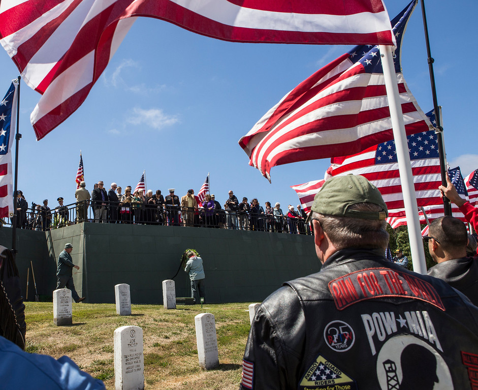. Members of the Patriot Guard Riders hold flags during the interment of Sgt. 1st. Class Joseph Steinberg at Golden Gate National Cemetery in San Bruno, Calif., on Aug. 1, 2013. (John Green/Bay Area News Group)