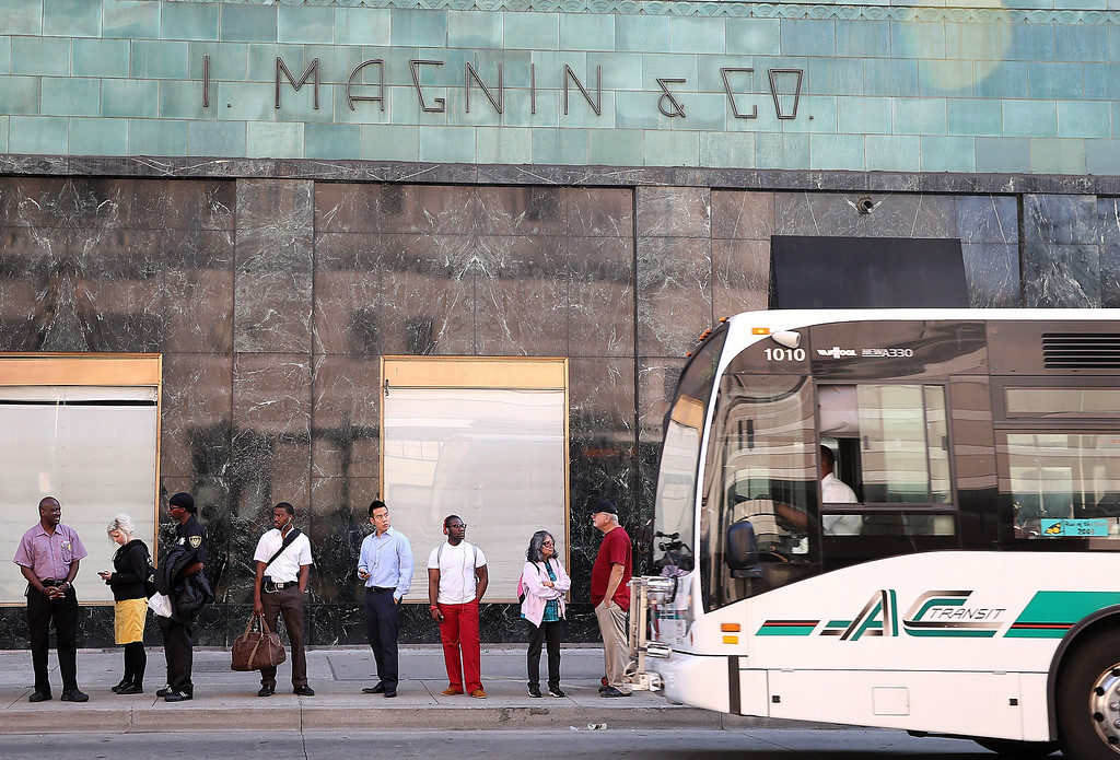 . Commuters line up to wait for an AC Transit bus on July 1, 2013 in Oakland, California. Hundreds of thousands of San Francisco Bay Area commuters are scrambling to find ways to work after the Bay Area Rapid Transit (BART) workers from the Amalgamated Transit Union Local 1555 went on strike at midnight after contract negotiations with management fell apart on Sunday. (Photo by Justin Sullivan/Getty Images)