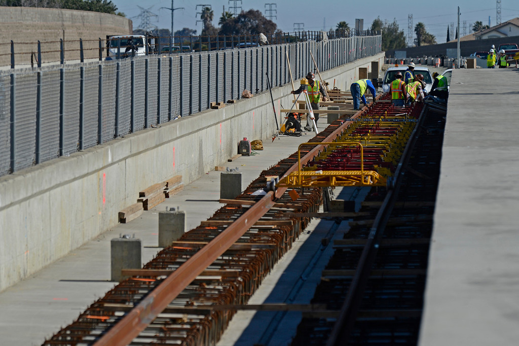 . Construction crews work on installing train tracks for the BART platform adjacent to the eBART platform located east of the BART station on Bailey Road  on Highway 4 in Pittsburg, Calif., on Monday, Feb. 11, 2013. Members of the media with state and local city officials traveled on a bus tour of the Highway 4 expansion project in East County. The tour took visitors to construction sites on Railroad Ave and the new eBART station being built on Bailey Road. (Jose Carlos Fajardo/Staff)