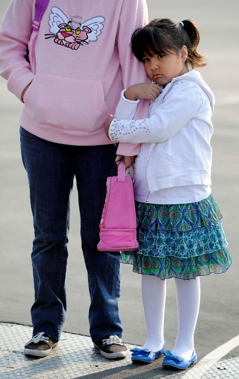 . Haley Rios, 6, a first grader on the first day of school at Mary Casey Black Elementary School, holds onto mom Laura Rios before school starts in Brentwood, Calif., on Tuesday, July 30, 2013. This is the 11th school Brentwood Union opened. (Susan Tripp Pollard/Bay Area News Group)
