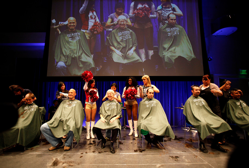 . Volunteers, including Pia Chamberlain, seated center, have their head shaved by volunteers for the St. Baldrick\'s Day head shaving event in support of research for pediatric cancer sponsored by the St. Baldrick\'s Foundation in the NetApp gymnasium at NetApp in Sunnyvale, Calif., on Thursday, March 14, 2013.  (Nhat V. Meyer/Staff)