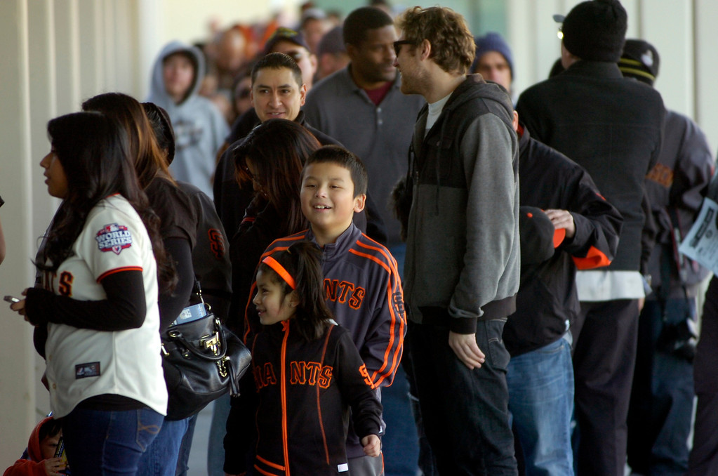. Fans wait in line to see the World Series Trophy as it makes a stop at the Richmond Memorial Auditorium in Richmond, Calif. on Monday, Jan. 14, 2013.  (Kristopher Skinner/Staff)