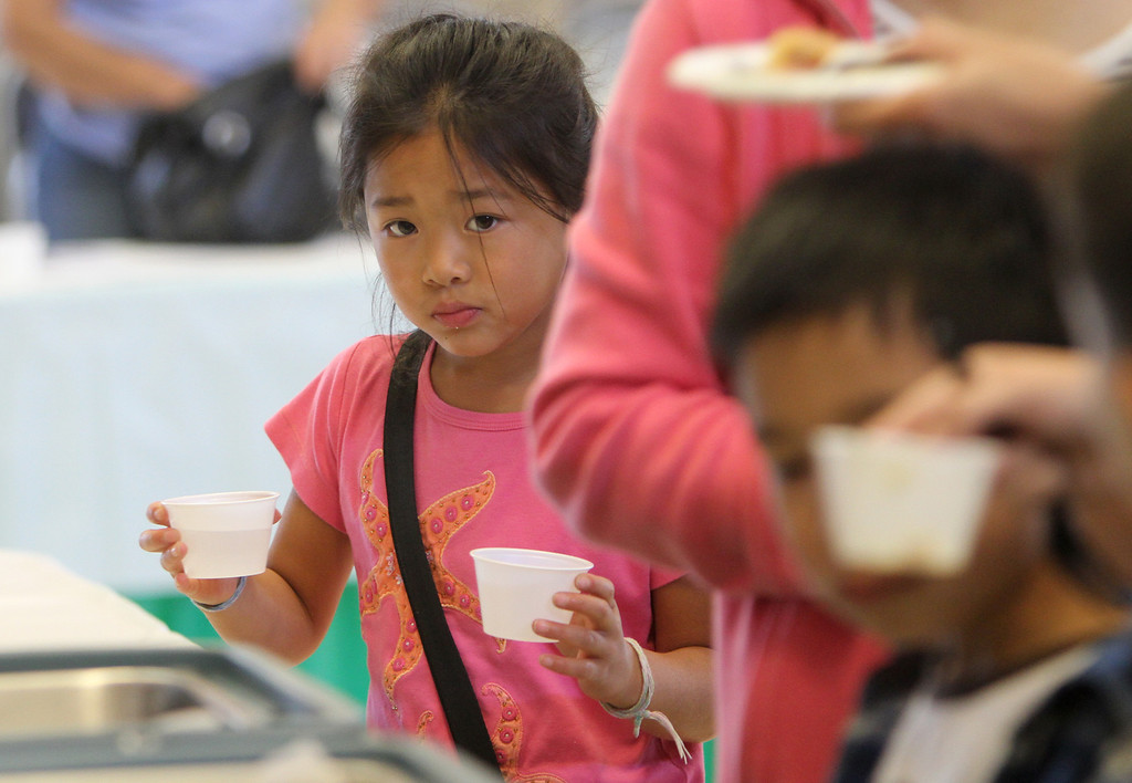 . Stephanie Lee, 8, samples new lunch items during a �tasting day� at Jane Lathrop Stanford Middle School in Palo Alto on Friday, Aug. 9, 2013. The Palo Alto Unified School District used the free event to showcase 23 new menu items, several of which were touted as local and organic. (Kirstina Sangsahachart/ Daily News)