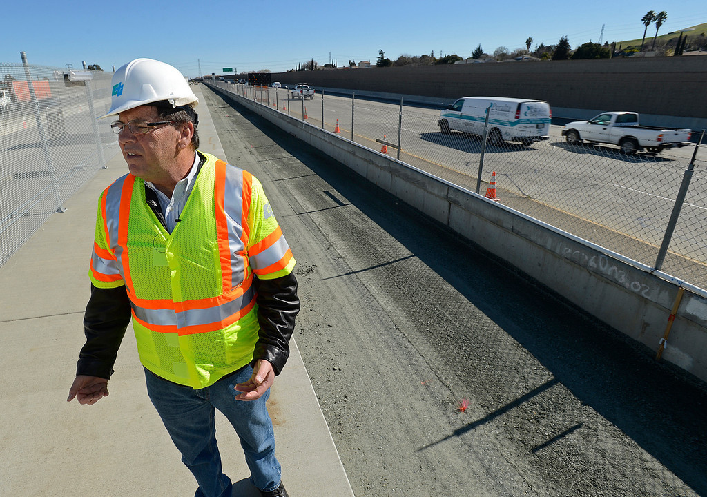 . BART board vice president Joel Keller stands next to the construction of a eBART platform at Bailey Road on Highway 4 in Pittsburg, Calif., on Monday, Feb. 11, 2013. Members of the media with state and local city officials traveled on a bus tour of the Highway 4 expansion project in East County. The tour took visitors to construction sites on Railroad Ave and the new eBART station being built on Bailey Road. (Jose Carlos Fajardo/Staff)