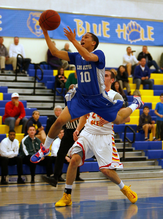 . Los Altos High School\'s Nate Vieira (10) gets a shot off against Willow Glen High School\'s Taylor Meeker (24) in the second period for the CCS Division II Boys Basketball semifinals at Santa Clara High School in Santa Clara, Calif., on Tuesday, Feb. 26, 2013.  (Nhat V. Meyer/Staff)