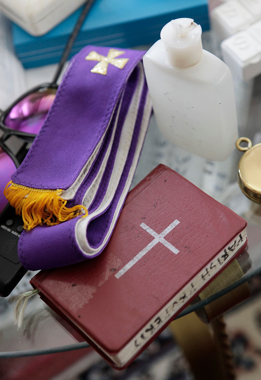 . Rev. Michael Gazzingan of St. Maria Goretti Church brings holy water, a purple stole representing the color of Lent, and prayer book during his home visits on Ash Wednesday in San Jose, Calif. on Wednesday, Feb. 13, 2013. Ash Wednesday marks the first day of Lent. Ashes are placed on the foreheads of Christians in the sign of the cross as a sign of mourning and repentance.  (Gary Reyes/ Staff)