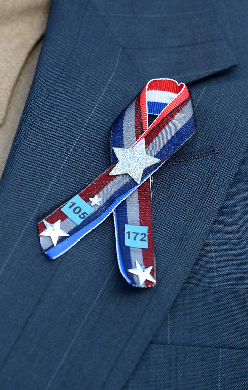 . Ribbons are being worn by some employees of the City of Santa Cruz are photographed at the HP Pavilion in San Jose, Calif. on Thursday, March 7, 2013. Thousands are expected at the pavilion to mourn the loss of the two Santa Cruz police officers who lost their their lives in the line of duty on Feb. 26. (Dan Honda/Bay Area News Group)