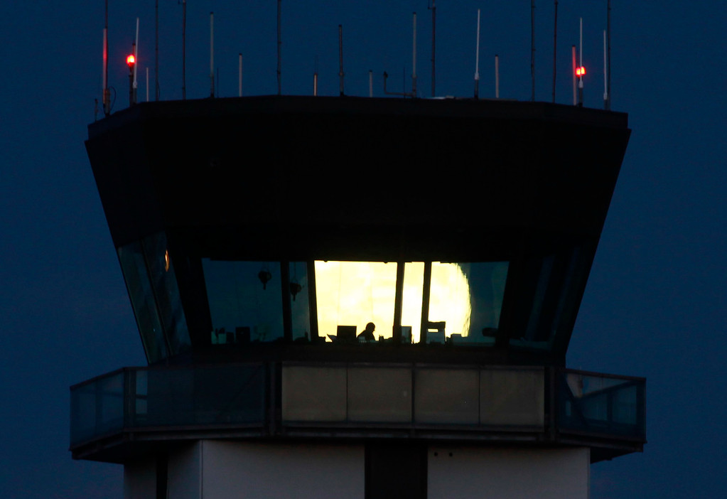 . The supermoon rises behind the air traffic control tower at Mineta San Jose International Airport Sunday evening, Aug. 10, 2014. (Karl Mondon/Bay Area News Group)