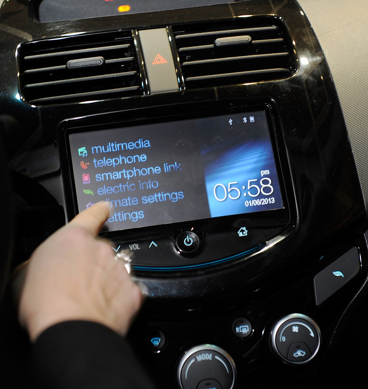 . A MyLink menu is displayed inside a Chevorlet Spark electric car during a press event at the Mandalay Bay Convention Center for the 2013 International CES on January 6, 2013 in Las Vegas, Nevada. (Photo by David Becker/Getty Images)