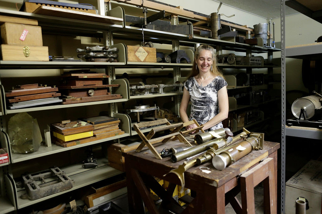 . Astronomer Elinor Gates is surrounded by old instruments in the scientific objects archive room at Lick Observatory east of San Jose, Calif. on Wednesday, May 8, 2013. The observatory will be celebrating its 125th anniversary.  (Gary Reyes/ Bay Area News Group)