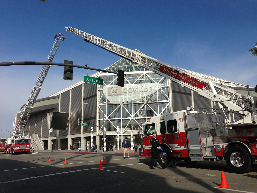 . The San Jose Fire Department sets up a ladder bridge at Autumn and Santa Clara in front of HP Pavilion on Thursday, March 7, 2013, in San Jose, Calif. (Gary Reyes/Bay Area News Group)