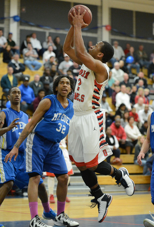 . Mt. Eden High\'s Jalen Dominic (32) left, watches as Dublin High\'s Cameron Moses (2) takes a shot in the first period of their NCS Division II boys basketball semifinal game in Dublin, Calif., on Wednesday, Feb. 27, 2013. Dublin High went on to win the game 85-53. (Doug Duran/Staff)