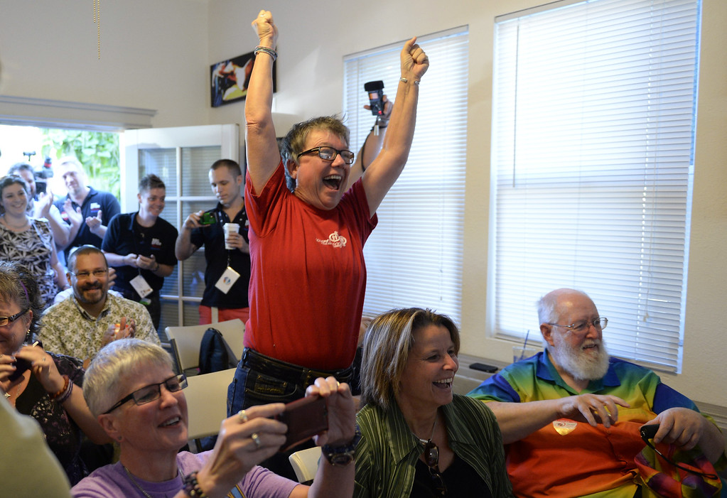 . Tina Reynolds celebrates the Supreme Court decision at the LGBT Sacramento Community Center on Wednesday, June 26, 2013, in Sacramento, Calif. The Supreme Court on Wednesday struck down a provision of a U.S. law denying federal benefits to married gay couples and cleared the way for the resumption of same-sex marriage in the state of California. The justices issued two 5-4 rulings in their final session of the term. One decision wiped away part of a federal anti-gay marriage law that has kept legally married same-sex couples from receiving tax, health and pension benefits. The other was a technical legal ruling that said nothing at all about same-sex marriage, but left in place a trial court\'s declaration that California\'s Proposition 8 is unconstitutional. (AP Photo/The Sacramento Bee, Hector Amezcua)