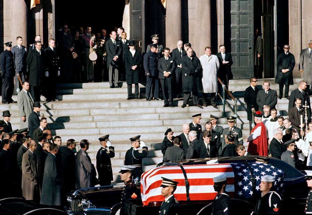 . A general view outside St. Matthew\'s Cathedral in Washington, D.C., during President John F. Kennedy\'s funeral, with flag-draped coffin in the foreground, Nov. 25, 1963. The president\'s brothers can be seen behind the casket. At left is Sen. Edward M. Kennedy (D-Mass.), and at right entering limousine is Attorney General Robert F. Kennedy.   (AP Photo)