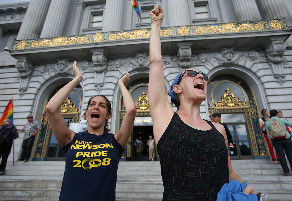 . Friends Meredith Sadim, and Angie Bush, both of San Francisco, celebrate at City Hall in San Francisco, Calif., on Wednesday, June 26, 2013. The U.S. Supreme Court dismissed California\'s Proposition 8 and declared the 1996 Defense of Marriage Act unconstitutional. (Jane Tyska/Bay Area News Group)