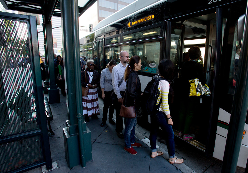 . AC Transit riders squeeze into a TransBay bus, as BART commuters scrambled to find alternative routes to San Francisco on the first day of a strike by workers of the mass transit system, Monday, July 1, 2013 in Oakland, Calif. (D. Ross Cameron/Bay Area News Group)