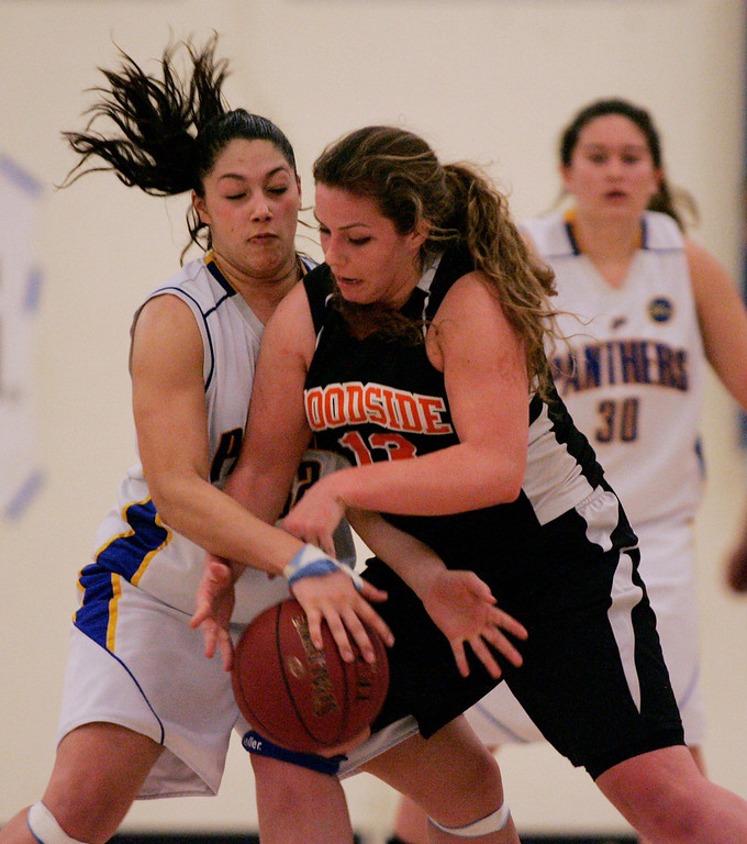 . Presentation\'s Jeanelle Schneider tries to steal the ball from Woodside\'s Madison Michelis in the fourth quarter during the CCS Division II girls basketball finals at Santa Clara High School in Santa Clara, Calif. on Friday, March 1, 2013. The Presentation Panthers beat the Woodside Wildcats, 49-34. (Jim Gensheimer/Staff)