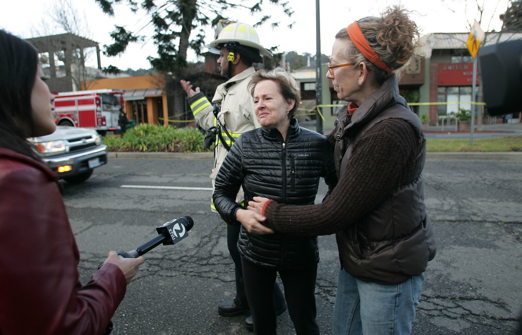 . Alice Waters, center, owner and executive chef of world famous Chez Panisse restaurant in Berkeley, is comforted by longtime pastry chef Mary Jo Thorsen after finishingd a tour of her fire damaged restaurant on Friday March 8, 2013. Officials are calling the fire, which started under the front porch, suspicious. (Doug Oakley/Staff)