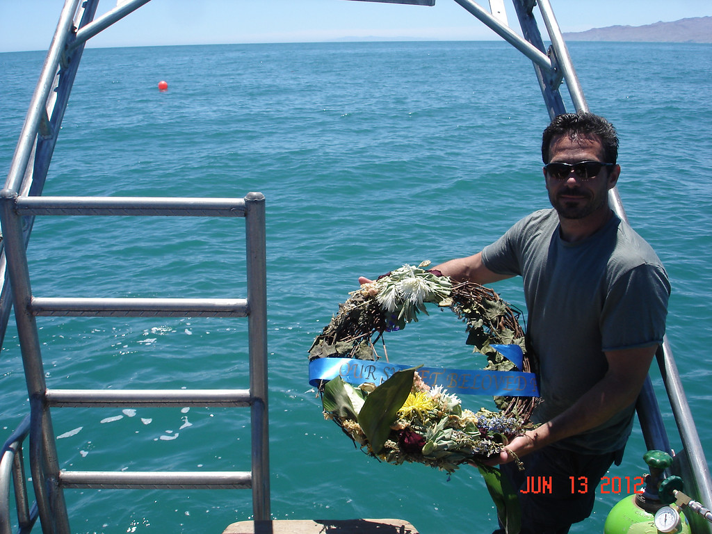 . Joe Jacinto places a wreath at the site of the Erik\'s wreckage. The buoy marks the spot above where the boat sits on the sea floor.   (Courtesy of Joe Jacinto)