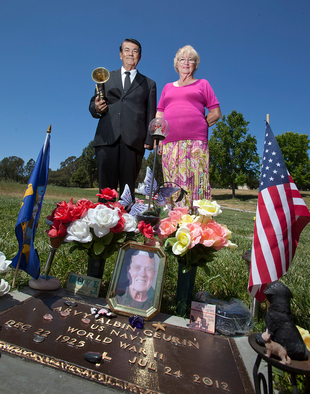 . Kenneth Weir and Gale Geurin stand at the grave of Geurin\'s late husband, Arvy, in Santa Cruz Thursday, May 23, 2013.  (Patrick Tehan/Bay Area News Group)