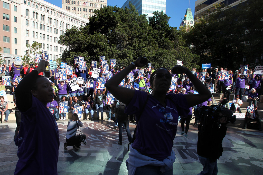 . Unions members and supporters of BART workers cheer as union leaders and community members speak during a rally at Frank Ogawa Plaza in Oakland, Calif., on Thursday, Aug. 1, 2013. (Ray Chavez/Bay Area News Group)