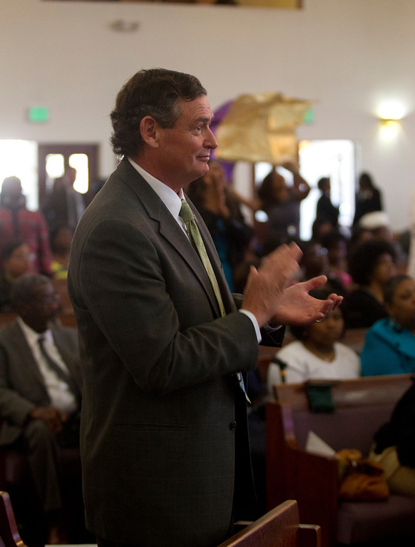 . California State University Chancellor Timothy White claps to the music during a service at Glad Tidings Church of God in Christ, Sunday, March 10, 2013 in Hayward, Calif. White visited the church as part of the annual Super Sunday event to encourage African Americans to attend college. (D. Ross Cameron/Staff)