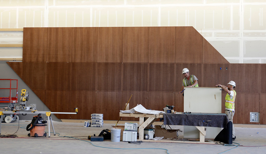 . Workers Dan Rubenstein and Jerod Neilsen install sound panels in the Grand Ballroom in the new 125,000-square-foot  expansion of the San Jose McEnery Convention Center in San Jose, Calif. on Tuesday, Aug. 6, 2013.  (Gary Reyes/Bay Area News Group)
