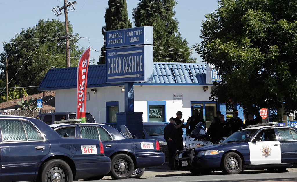 . The San Jose Police Depart check out the check-cashing store at Diana Lane and Story Rd. where a gunman made a robbery attempt in East San Jose, Calif. on Thursday, Aug. 1, 2013. The gunman escaped that led to a large manhunt. (Gary Reyes/Bay Area News Group)