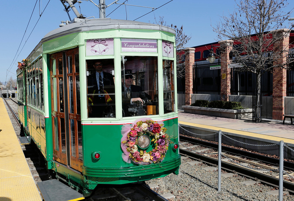 . Historic trolley, Car 2001, arrives at the Diridon Station carrying Ralph and Mary Lou Watkins and their guests during their 60th wedding anniversary party on Valentine\'s Day in San Jose, Calif. on Thursday, Feb. 14, 2013. Ralph, 82, and Mary Lou, 79, won an essay contest sponsored by the Santa Clara Valley Transportation Authority to have the opportunity to renew their vows on the historic trolley. The couple held a private ceremony aboard the trolley, then held a brief reception on the VTA Light Rail platform.  (Gary Reyes/ Staff)