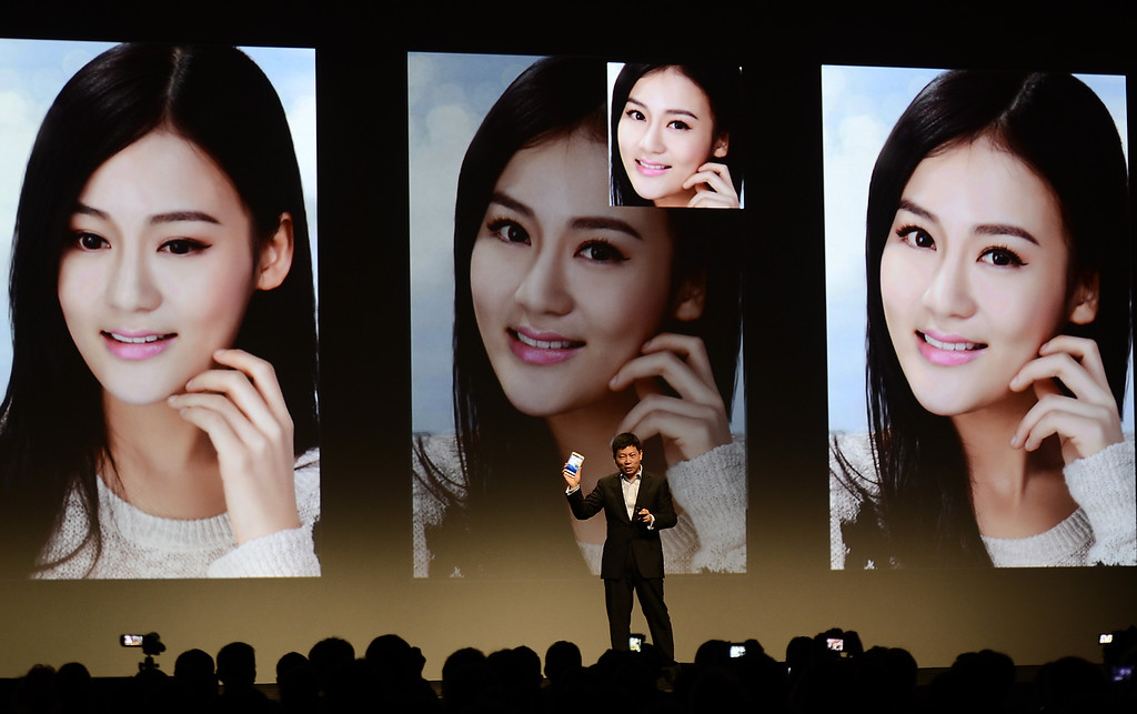 . Richard Yu ,CEO of Huawei Consumer Business Group, speaks as Huawei unveils new smart phone Hyawei Ascend Mate 2 4G during a press event at the Mandalay Bay Convention Center for the 2014 International CES on January 6, 2014 in Las Vegas, Nevada. (JOE KLAMAR/AFP/Getty Images)