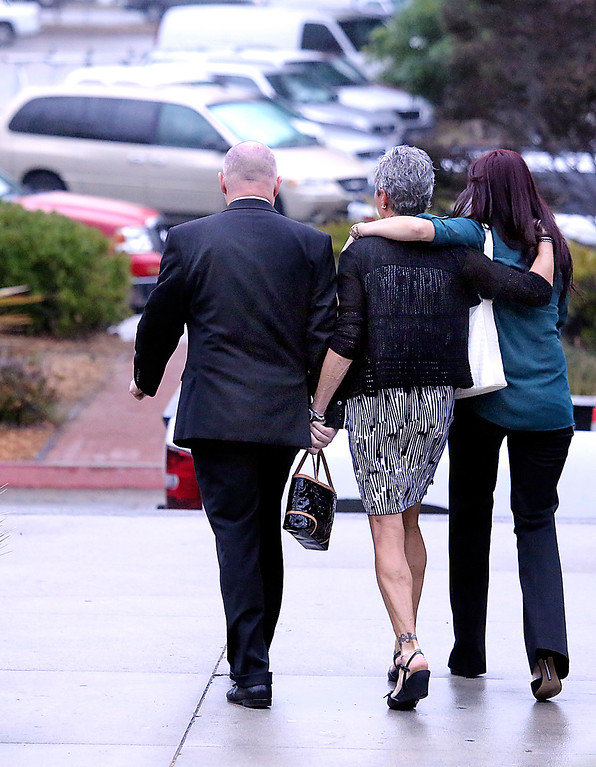 . Alix Tichelmanís parents Bart and Leslie Tichelman and her sister Monica Tichelman leave the Santa Cruz County Courthouse after Wednesday\'s arraignment. (Shmuel Thaler/Santa Cruz Sentinel)