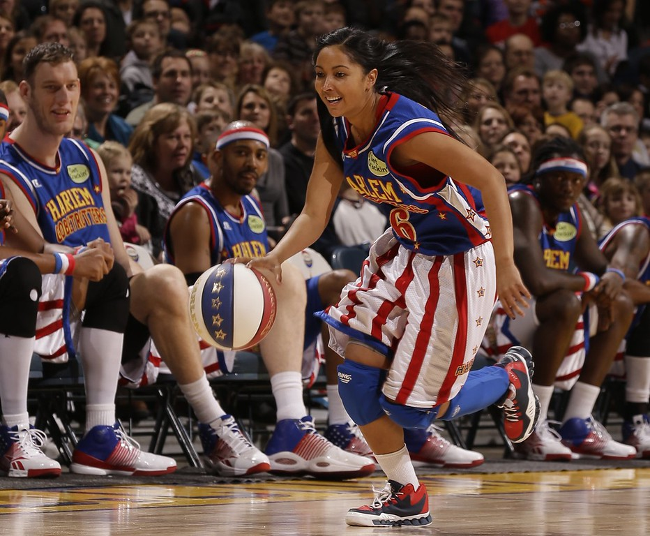 ". Oakland native Tammy Brawner, who plays under the moniker ""T-Time\"" returns to the Bay Area as a member of the Harlem Globetrotters, who will perform locally  Jan. 19-20, 2013.  Brawner, the 10th woman in the 87-year history of the famous basketball troupe, will be the only female on thefloor for this leg of the Globetrotters\' tour.Photo courtesy of Harlem Globetrotters"