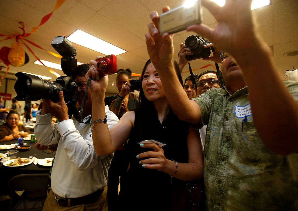 . Supporters of Cindy Chavez photograph her on election night for the Santa Clara County District 2 supervisor at the South Bay AFL-CIO Labor Council headquarters in San Jose, Calif. on Tuesday, July 30, 2013.  (Nhat V. Meyer/Bay Area News Group)