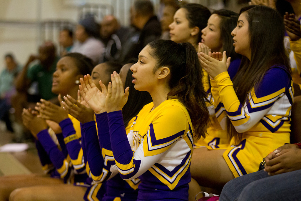 . Oakland Technical High School cheerleaders urge on their team against conference foe McClymonds High School during an Oakland Athletic League girls\' basketball game, Wednesday, Feb. 20, 2013 in Oakland, Calif. McClymonds won, 62-50. (D. Ross Cameron/Staff)