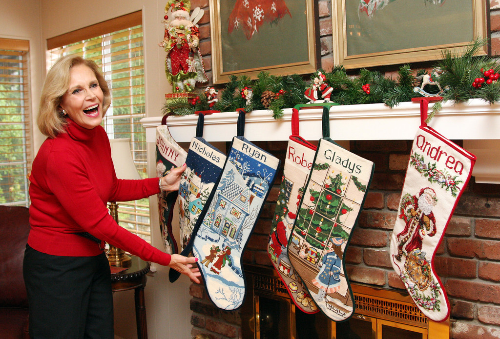 . Gladys Young shows the needlepoint stockings she made for each family member in her Danville, Calif., home on Wednesday,  Nov. 28, 2012. The stockings hang from the mantel in the family room. (Jim Stevens/Staff)