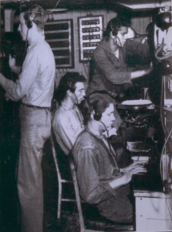 . Arvy Geurin, standing on right, in the radio room of the USS Napa in 1945. Geurin of Santa Cruz, who landed on the beaches of Iwo Jima while serving in the Navy, died at age 87 and is buried in Santa Cruz Memorial. Milpitas trumpet player Kenneth Weir, a Navy veteran and Buglers Across America member, performed at Geurin\'s service.  (Courtesy of Gale Geurin)