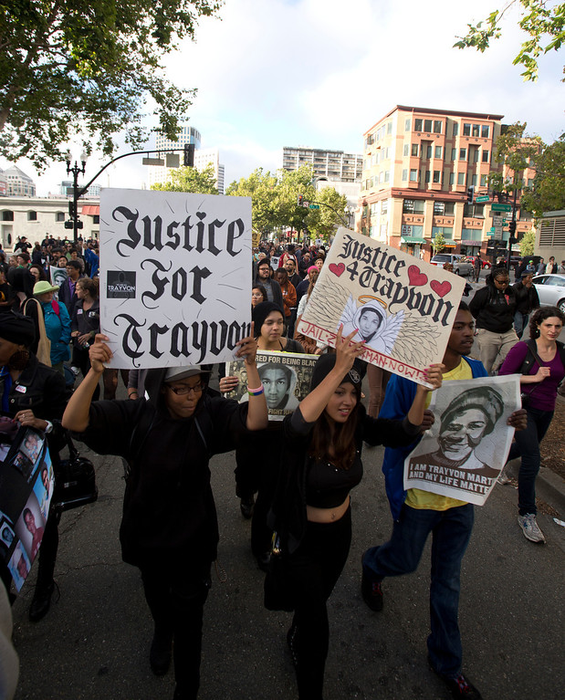 . Marchers chant slogans as they move down Broadway during a protest of the verdict in the Trayvon Martin murder trial last Saturday in Sanford, Fla., Monday, July 15, 2013 in Oakland, Calif. (D. Ross Cameron/Bay Area News Group)