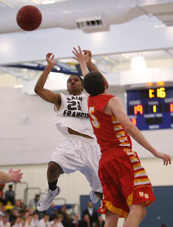 . St. Francis\' Khalil Johnson shoots on Willow Glen\'s Mikey Riley in the first quarter during the CCS Division II boys basketball finals at Santa Clara High School in Santa Clara, Calif. on Friday, March 1, 2013. The Saint Francis Lancers played the Willow Glen Rams. (Jim Gensheimer/Staff)