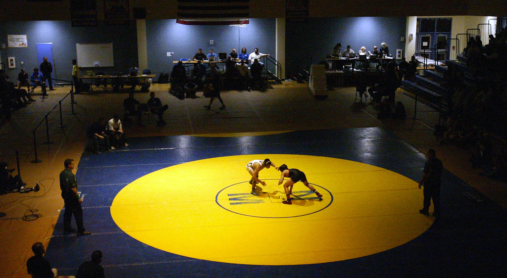 . Granada\'s Angel Beltran, left , faces off against James Logan\'s Jacob Macalolooy in the 138-pound finals at the North Coast Section wrestling championships held at Newark Memorial High School in Newark, Calif., on Saturday, Feb. 23, 2013. Macalolooy would get the win. (Anda Chu/Staff)