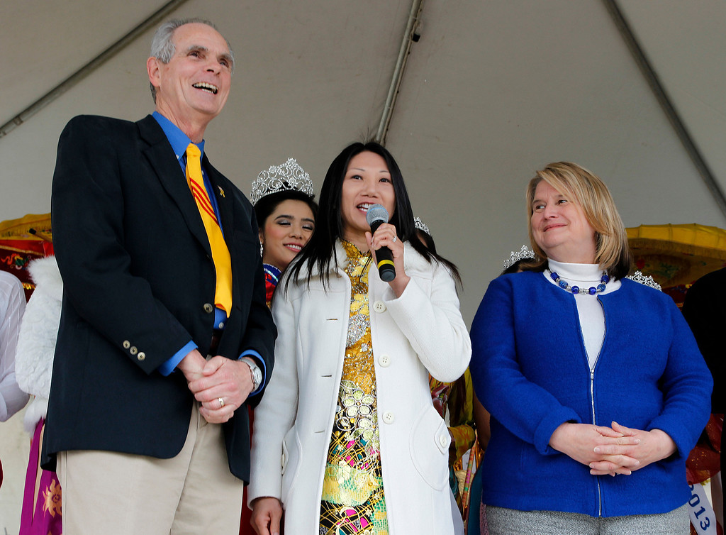 . From left, San Jose Mayor Chuck Reed, Vice Mayor Madison Nguyen and City Councilwoman Rose Herrera speak at the Tet festival hosted by the Coalition of Nationalist Vietnamese Organizations of Northern California (CONVONCA) at the Santa Clara County Fairgrounds in San Jose, Calif. on Saturday, February 2, 2013.   (LiPo Ching/Staff)