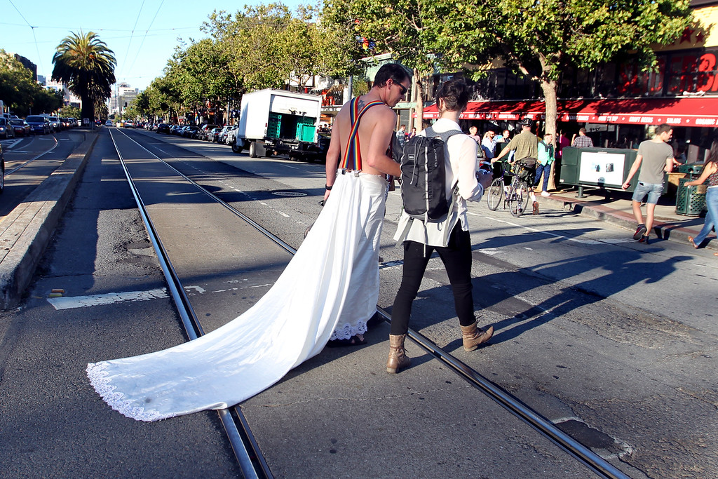 . Joseph Copley, left, of Oakland, wears a wedding gown as he crosses Market Street in the Castro District in San Francisco, Calif., on Wednesday, June 26, 2013.  The LGTB community celebrate the Supreme Court\'s decision on Proposition 8 and the Defense of Marriage Act.  (Ray Chavez/Bay Area News Group)